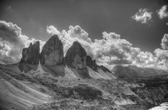 Drei Zinnen in a cloudy day of summer, Dolomites, Alps, Italy Stock Image