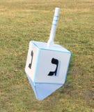 Dreidel. A large size dreidel on grass background Stock Photography