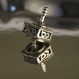 Dreidel. Reflection of  hanukkah silver dreidel Royalty Free Stock Photography