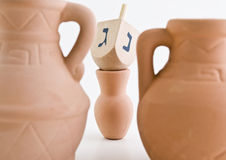 Dreidel and Oil Jug Royalty Free Stock Images
