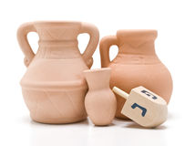 Dreidel and Oil Jug Stock Photos