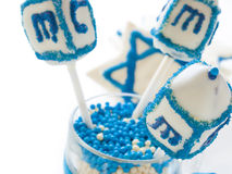 Dreidels. Gourmet dreidels decorated with white icing for Hanukkah Stock Image