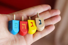 Dreidels. Hanukkah Dreidels presented on a hand, each dredel has a unique different color and letter