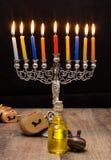 Dreidels and a menorah. Hanukkah Royalty Free Stock Image