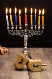 Dreidels and a menorah. Hanukkah Stock Image