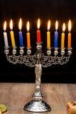 Dreidels and a menorah. Hanukkah Stock Photo