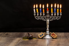 Dreidels and a menorah. Hanukkah. Text-Israel Royalty Free Stock Photos