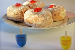 Dreidels and Sufganiyot  on the Jewish festival of Hanukkah Royalty Free Stock Image
