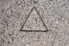 Dreieck im Stein Lizenzfreie Stockfotos