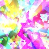 Dreieckfeier buntes Confettiglühen Stockfotografie
