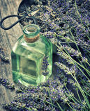 Dreied lavender flowers with herbal oil and scissors. Vintage st Stock Images