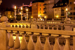 Dreifache Brücke in Ljubljana nachts Stockfotografie