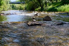 River in the city of Freiburg, Germany, stones stock images