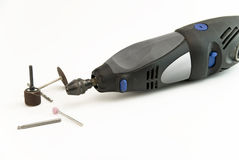 Dremel drill with tools. Dremel drill with different tools stock photos