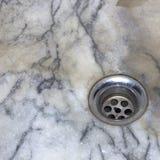 Dren del agua del agujero del lavabo Imágenes de archivo libres de regalías