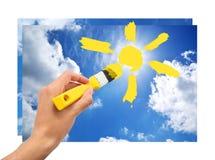 Drenaje de la mano el sol en cielo Fotos de archivo libres de regalías