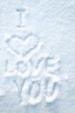 Drenaje del corazón en smow con las palabras TE AMO Fotografía de archivo libre de regalías