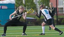 Drenaje del lacrosse de las muchachas Fotos de archivo
