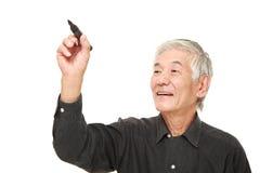 Drenaje japonés mayor del hombre en el aire Foto de archivo