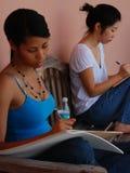 Drenaje negro y asiático de las muchachas Fotografía de archivo libre de regalías