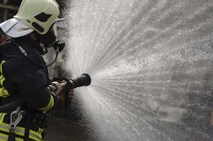 Drenched Firefighter Royalty Free Stock Photos