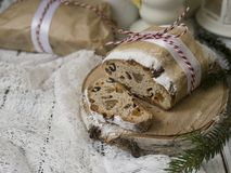 Dresden Christmas Stollen with raisins, dried apricots, dried cherries, nuts and candied fruits in sugar powder on a festive royalty free stock photo