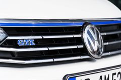 Plug-in hybrid electric car Volkswagen Golf GTE stands by charging station in front of the Glaserne Manufaktur. DRESDEN, GERMANY - APRIL 2 2018: Plug-in hybrid Royalty Free Stock Photo