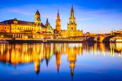 Dresden, Germany. Cathedral of the Holy Trinity or Hofkirche, Bruehl`s Terrace. Twilight sunset on Elbe river in Saxony Royalty Free Stock Photography