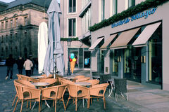 DRESDEN, GERMANY - December 25, 2012: ice-cream parlors in Dresden. Tables and chairs in the street Stock Images