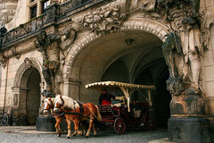 Dresden, Germany, December 19, 2016: A trip in a carriage with horses. Entertainment of tourists in Dresden. Europe Stock Image