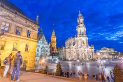 DRESDEN, GERMANY - JULY 15, 2016: Tourists along old city street. S at night. Dresden attracts 5 million tourists annually Royalty Free Stock Photos