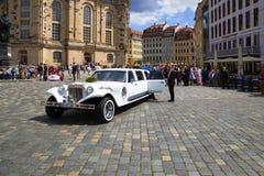 Wedding with long white limousine Stock Photos