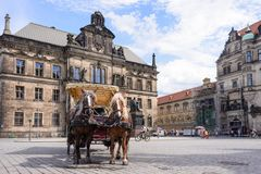 DRESDEN, GERMANY - MAY 2017: a horse and carriage carries tourists in Dresden, Germany Royalty Free Stock Images
