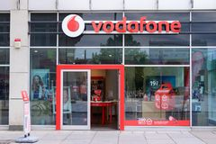 DRESDEN, GERMANY - MAY 2017: Vodafone shop sign, company based in the UK. It provides mobile phone, DSL, LTE, cable internet, land