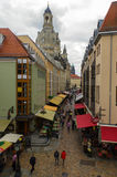 DRESDEN, GERMANY - SEPTEMBER 21, 2013: Pedestrians in the Munzgasse alleyway. The historic cobblestone alley is lined with many of Stock Image