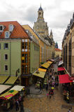 DRESDEN, GERMANY - SEPTEMBER 21, 2013: Pedestrians in the Munzgasse alleyway. The historic cobblestone alley is lined with many of Stock Photography