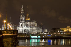 Dresden at Night. Night scene in Dresden, Germany, river Elbe and The Catholic Church of the Royal Court of Saxony St. Trinitatis Royalty Free Stock Images