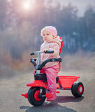 Baby on red bike stock images