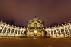 Dresden Zwinger palace panorama with illumination at night Stock Photos