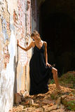 Dress. The girl in the ruins of ancient castle Stock Image