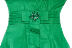 Dress. Woman in green dress with brooch Royalty Free Stock Image