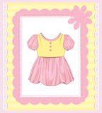 Dress for baby girl. Background with  dress for baby girl Royalty Free Stock Images