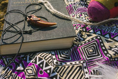 Dress and book lying on dry land. hipster style Stock Images