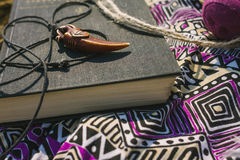Dress and book lying on dry land. hipster style Royalty Free Stock Photo