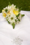 Dress Bouquet. A brides flower bouquet on her dress Royalty Free Stock Image