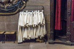 Dress of catechumen teenagers hanging in the sacristy of the dom Royalty Free Stock Image