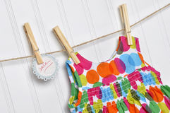 Dress on a Clothesline with Handwritten Sale Sign Stock Photos
