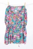Dress on clothespins Stock Photos