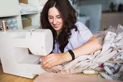 Dress designer making lace wedding dresses. Royalty Free Stock Photography