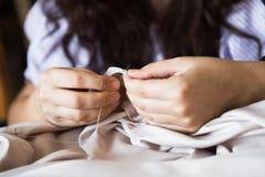 Dress designer making lace wedding dresses. Handmade royalty free stock photography